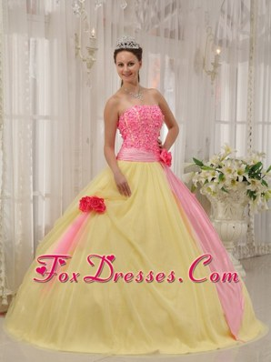 Pink And Yellow Strapless Quinceanera Dress With Floral Embellishments