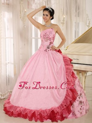 Asymmetrical Ruffled Pink Quinceanera gown with Appliques