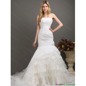 Elegant Strapless Wedding Dress with Ruching and Ruffles