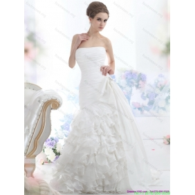 Affordable White Strapless Wedding Dresses with Ruffled Layers and Brush Train