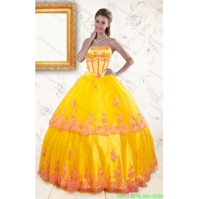 2015 Couture Strapless Gold Quinceanera Dresses with Appliques