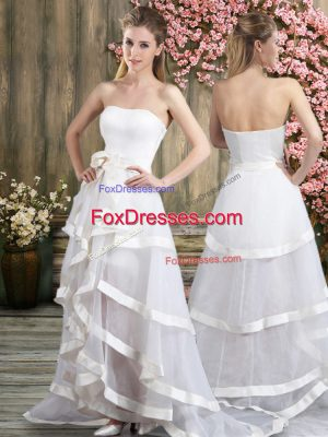 Suitable Sleeveless Tulle Sweep Train Backless Wedding Gown in White with Ruffled Layers and Belt