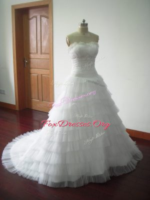Ball Gowns Sleeveless White Bridal Gown Brush Train Lace Up