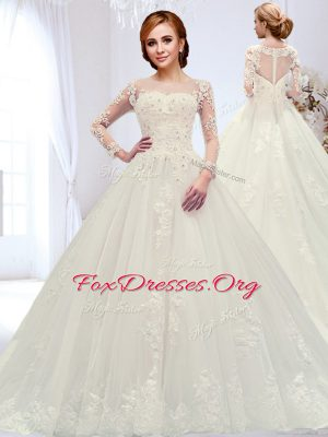 Fitting Scoop Long Sleeves Wedding Gowns With Train Court Train Beading and Appliques White Tulle