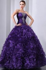2013 Dark Purple Beaded Quinceanera With Rolling Flower