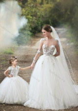 Most Popular See Through Long Sleeves Wedding Dresses with Appliques and Lovely Big Puffy Flower Girl Dress with Hand Made Flowers