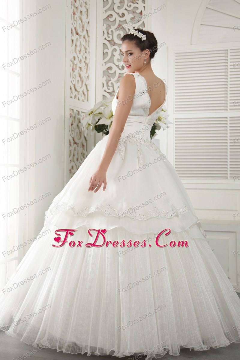 exquisite ivory floor length wedding dress