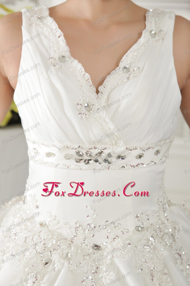 simple wedding dress with beading and ruche
